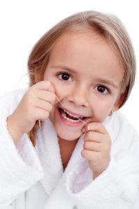 girl flossing